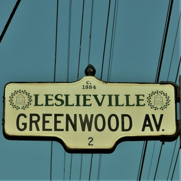 street sign - greenwood ave @ queen st e