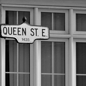 street sign - queen st e w. window @ greenwood