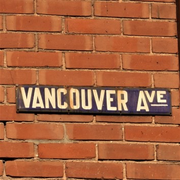 street sign - vancouver ave @ queen st e