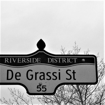 street sign - de grassi st @ queen st e